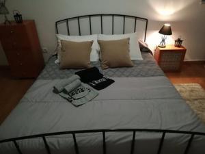 A bed or beds in a room at Evora Romana Alojamentos T1 Templo Diana