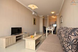 Телевизор и/или развлекательный центр в Rotonda Inn Novigrad