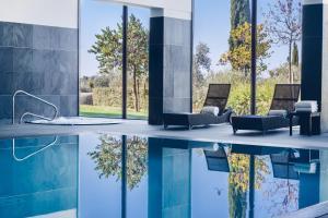 A piscina em ou perto de Convento do Espinheiro, Historic Hotel & Spa