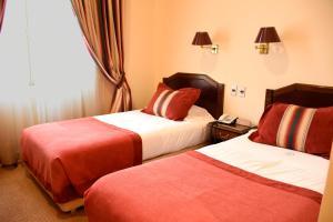 Cama o camas de una habitación en Hotel José Nogueira