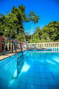 The swimming pool at or near Pousada Canto do Curió Paraty