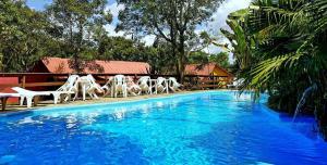 The swimming pool at or near Pousada da Serra da Luz