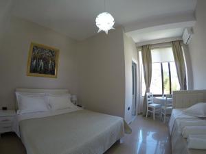 Cama o camas de una habitación en Hotel Orestiada