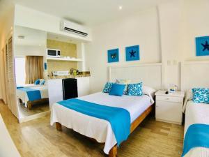 Cama o camas de una habitación en Beachfront suite in the best location!