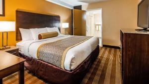 A bed or beds in a room at Best Western Cape Cod Hotel