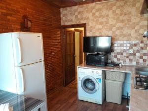 Uma TV ou centro de entretenimento em CENTER. 3 Bedrooms