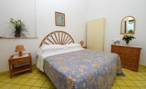 Letto o letti in una camera di Villa Maria Antonietta