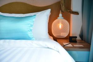 Кровать или кровати в номере T2 Jomtien Pattaya