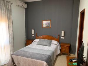 Cama o camas de una habitación en Hotel-Restaurante la Loma