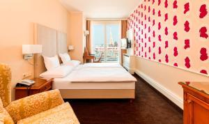 Ein Bett oder Betten in einem Zimmer der Unterkunft Hotel Am Parkring