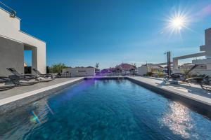 The swimming pool at or close to Villa Magnifica Luxury Apartments