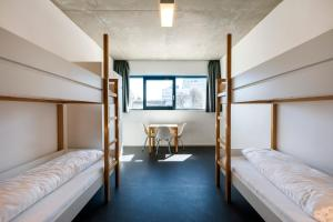 A bunk bed or bunk beds in a room at Jugendherberge Schweinfurt