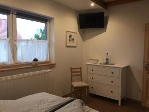 Ein Bett oder Betten in einem Zimmer der Unterkunft Gut Fischer