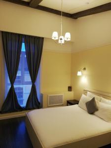 Кровать или кровати в номере Residence Turgenev