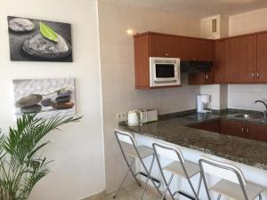 A kitchen or kitchenette at Residencial Neptuno