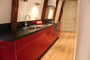 A kitchen or kitchenette at Amsterdam Jewel Canal Apartments