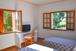 A television and/or entertainment center at Veinat de les Ferreries Villa Sleeps 18 Pool WiFi