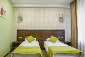 Кровать или кровати в номере Колибри