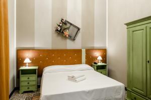 Letto o letti in una camera di Vo Al Guest House Genova Center