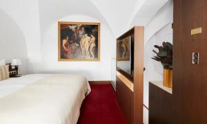 A bed or beds in a room at Living Hotel De Medici