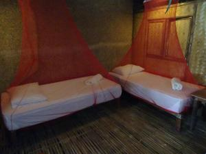 A bed or beds in a room at Palawan SandCastles