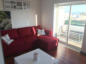 A seating area at Appartement plein centre du vieux Faro