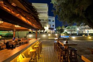 A restaurant or other place to eat at Aphrodite Beach