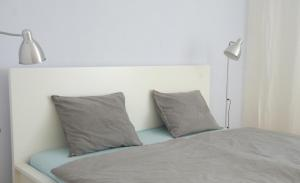 A bed or beds in a room at Casa Margarida Azul