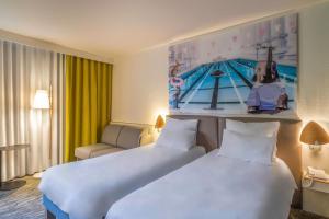 Un ou plusieurs lits dans un hébergement de l'établissement Novotel Paris Créteil Le Lac