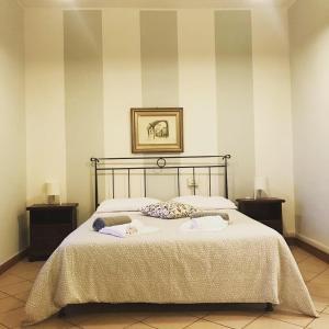 Letto o letti in una camera di Ostello di Biella