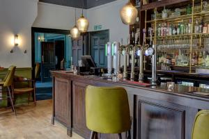 The lounge or bar area at Hallgarth Manor House