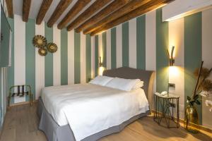 Un ou plusieurs lits dans un hébergement de l'établissement Hotel Tiziano