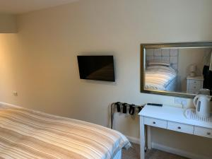 A television and/or entertainment center at Fornham Guest House