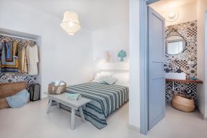 A bed or beds in a room at I Colmi - Trulli Suites