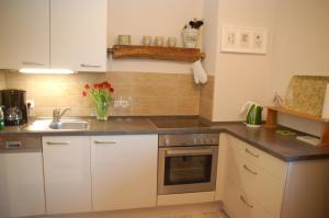 Küche/Küchenzeile in der Unterkunft Ferienwohnung Bodden