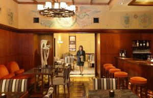 A restaurant or other place to eat at Hotel Britania - Lisbon Heritage Collection