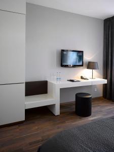TV o dispositivi per l'intrattenimento presso MOODs boutique hotel