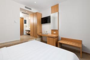 Ein Bett oder Betten in einem Zimmer der Unterkunft Lindos Royal Resort