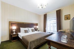 Кровать или кровати в номере Татарская Усадьба
