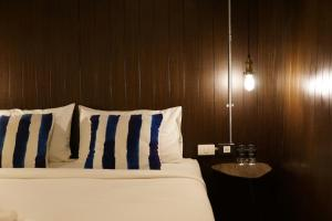 A bed or beds in a room at STrips the Poshtel