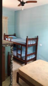 A bunk bed or bunk beds in a room at Pousada Borboleta Azul