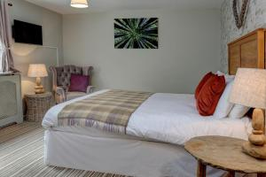 A bed or beds in a room at New Hobbit Hotel