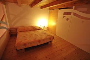 A bed or beds in a room at Loft Panoramico al Centro Storico