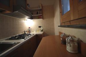 A kitchen or kitchenette at Loft Panoramico al Centro Storico
