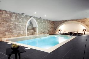 The swimming pool at or near Real Abadia, Congress & Spa Hotel