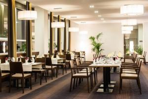 A restaurant or other place to eat at Congress Hotel Centrum