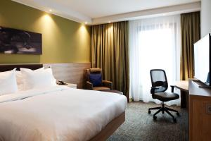 A bed or beds in a room at Hampton By Hilton Aachen Tivoli