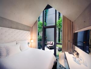 A bed or beds in a room at M Social Singapore (SG Clean, Staycation Approved)