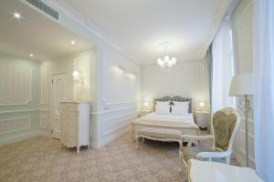 Кровать или кровати в номере Отель Екатерина Кострома