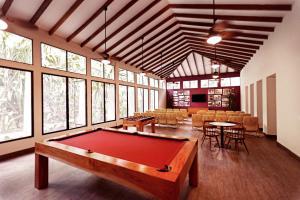 A pool table at Jungle Lodge Tikal Hostal